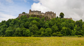 Stirling Castle through trees on a spring day Stock Images