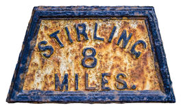 Stirling Mile Marker Sign. Old Fashioned Rusty Mile Marker For Stirling In Scotland royalty free stock photo