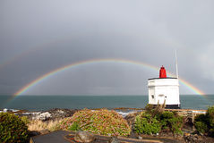 Stirling Point Rainbow. A rainbow behind Stirling Point Lighthouse at Bluff, New Zealand Stock Image