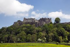 Stirling Castle cloudy blue sky. Stirling, Scotland. MAY 25 2017, STIRLING CASTLE -  summer view of the iconic Stirling Castle. Stirlingshire, Scotland, UK Royalty Free Stock Photography
