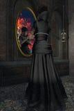Stirrar den onda styvmor för sagan in i den magiska spegeln arkivbild