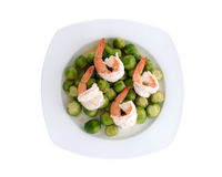 Stirred Brussels sprouts with shrimps on plate Stock Photo