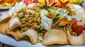 Fried noodle with shrimp crackers, Asian culinary. Stirred fried noodle with shrimp crackers, Asian culinary Stock Image