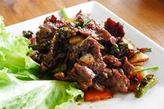 Stirred fried ostrich with garlic and black pepper. Stock Images