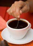 Stirring black coffee Stock Image