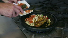 Stirring Chick Dish in a pan stock video footage