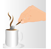 Stirring the coffee. Hand stirring hot coffee over gray background Stock Photo