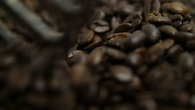 Stirring coffee beans with paddle stock footage