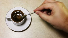 Stirring the coffee in the cup stock video footage