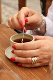 Stirring coffiee Stock Images