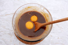 Stirring egg yolks into pecan pie filling Royalty Free Stock Photography