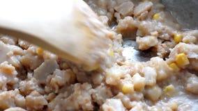 Stirring lobster corn chowder in skillet stock video