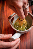 Stirring matcha tea Stock Photo