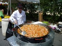 Stirring the Paella Royalty Free Stock Photography