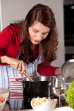 Stirring in the pan Royalty Free Stock Photo
