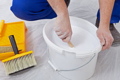 Stirring up paint Stock Photos