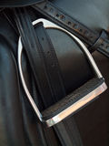 Stirrup at dressage saddle. close up Royalty Free Stock Photo