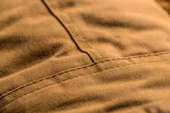 Stitch on brown coat Stock Photography