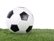 Stitch leather soccer ball on grass field Royalty Free Stock Image