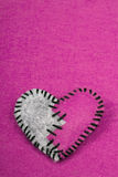 Stitched broken felt heart on a on pink background Royalty Free Stock Photos