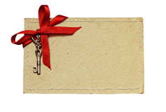 Stitched cardboard with red ribbon and a key for Valentine's day Royalty Free Stock Photography