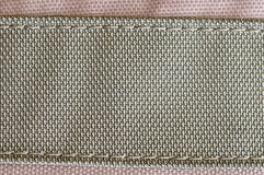 Stitched fabric. Background from two different fabrics, stitched thread Royalty Free Stock Image