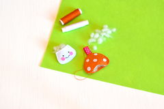 Stitched felt details, thread, needle, hollofayber - sewing set for felt toy mushroom. Kids crafts Royalty Free Stock Photo