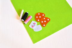 Stitched felt details, thread, needle - sewing set for felt toy mushroom. Kids crafts Royalty Free Stock Image
