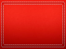 Stitched frame on Red leather Royalty Free Stock Photos