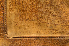 Stitched leather. Old, worn, aged leather textured background Royalty Free Stock Image