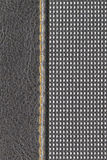 Stitched materials. Two materials stitched by orange thread Stock Photo