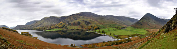 Stitched Panorama overlooking Buttermere Lake. In Autumn Cumbria Lake District in United Kingdom Stock Photos