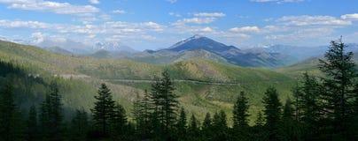 Stitched Panorama. Summer view of the mountain pass Olchan. Oymyakon, Yakutia. Тhe Federal highway `Kolyma» P504 stock photography