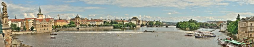 A stitched panoramic view or panorama banner of the Vltava river. In Prague, Czech Republic. There are ships on it and buildings on a river bank. The photo was Royalty Free Stock Photography