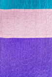 Stitched pieces of clenched silk fabrics Stock Image