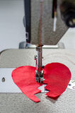 Stitched red cloth broken heart Royalty Free Stock Image