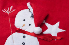 Stitched snowman on a red christmas sock. Stock Photography