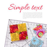 Stitched square pieces of fabric of quilt and ruler on white sur. Face Stock Photo