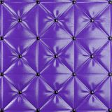 Stitched upholstery leather violet background with buttons. 3d rendering Royalty Free Stock Photo