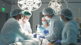 Surgeons perform a complex operation to save a human life at hospital stock footage