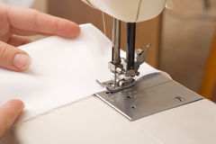 Stitching machine. Working on stitching machine with arms Stock Photos