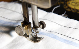 Stitching machine detail close-up. With textile Royalty Free Stock Photo