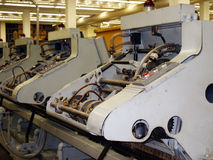 Stitching machines. Closeup of stitching machines in publishing house Royalty Free Stock Photos