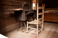 Stitching. A sewing machine and chair  from 1800s homestead Stock Images