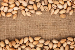 Stitching and sewing pistachios lying on sackcloth Stock Photo