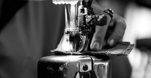Stitching a shoe part Royalty Free Stock Images
