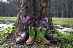 Stivali del figlio e della madre Fotografia Stock