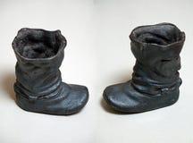 Stivali della colata della ghisa Colore nero Fotografia Stock Libera da Diritti