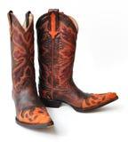 Stivali di cowboy di cuoio su fondo bianco Fotografia Stock