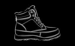 Stivali di inverno degli uomini su fondo nero Immagini Stock Libere da Diritti